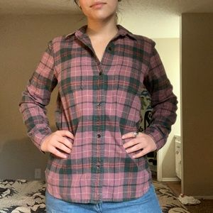 Plaid, flannel button up shirt.